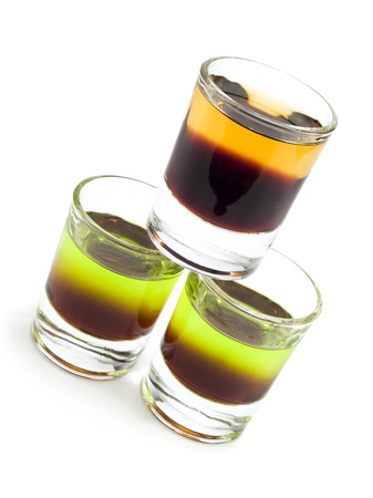 shit: Ingredients for Cockroach: 1 oz Kahlua 1 oz Scotch Whiskey  Ingredients for Shit on Grass: 1 oz Kahlua  1 oz Midori Melon Liqueur Stock Photo