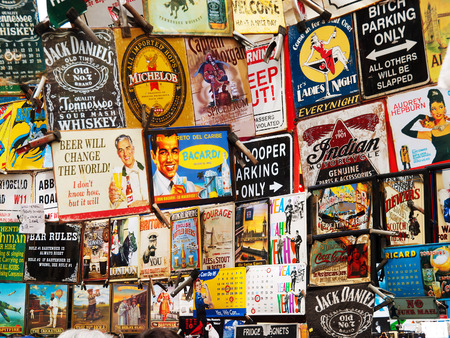 advertise: London, United Kingdom - May 22, 2009 : Vintage advertising labels on sale in Portobello Road market