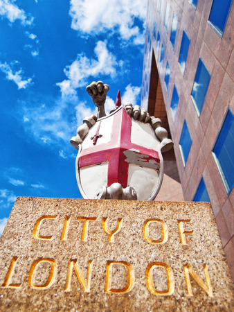 beheaded: London, United Kingdom - April 30, 2008 : The emblem of the city of London. It combines the cross of Saint George and the sword of Saint Paul that had been beheaded with it. The motto DOMINE DIRIGE NOS means Lord, direct us