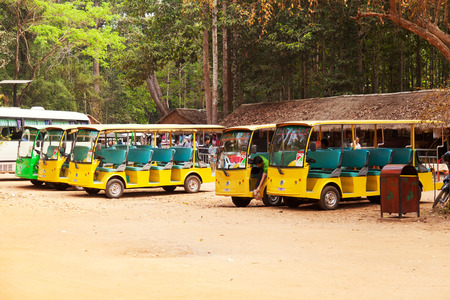 minibus: Angkor Wat, Cambodia - March 19, 2011 : Cambodian open minibus drivers waiting for tourists for a ride across the temples of ancient Angkor Editorial