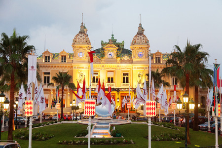 establishing: Monaco, Monaco - June 30, 2011 : Monte Carlo casino at dusk. The casino was opened in 1856 when the reigning Monaco?s family was almost bankrupt. They decided to save the kingdom by establishing a large German style casino. The casino hadnt enjoyed much