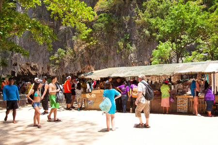 holiday movies: Phuket, Thailand - March 16, 2011 : Tourists shopping souvenirs from local gift shops at James Bond Island