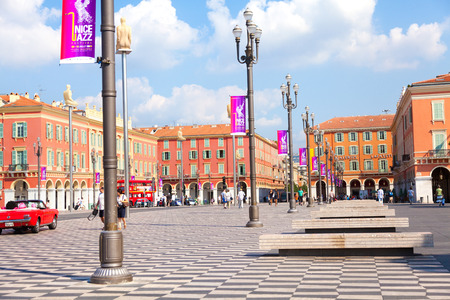 trackless: Nice, France - July 03, 2011 : Place Massena during the day - this is the main square of the city where a lot of summer events are held. Some people walking are seen in the distance. Editorial
