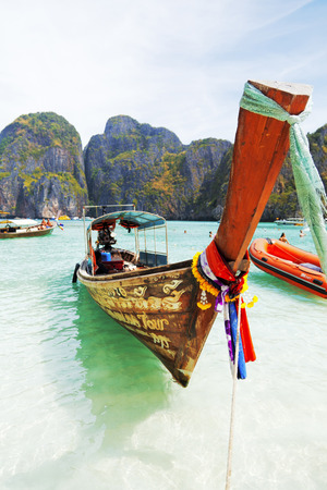 longtail: Maya Bay, Thailand - March 15, 2011 : One longtail boat in Maya bay waiting for the tourists that come to see the famous lagoon where The Beach movie has been shot