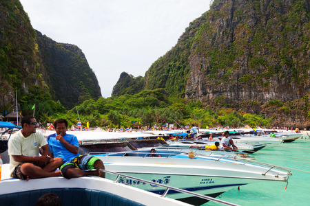 holiday movies: Maya Bay, Thailand - March 15, 2011 : Speedboats waiting to take away the tourists from Maya Bay main beach