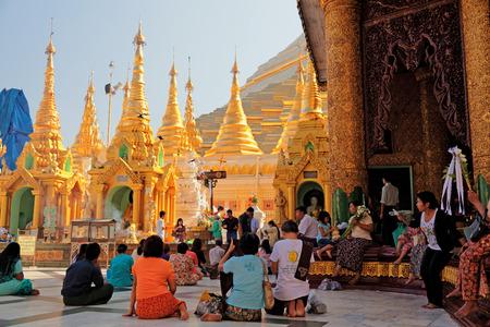 worshipping: Yangon, Myanmar - February 24, 2011 : Burmese people worshipping Buddha in Shwedagon Pagoda at midday Editorial