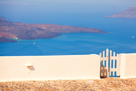 firostefani: Small gate in a private villa in Firostefani, Santorini, with a perfect view of the volcanic island Stock Photo