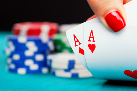 poker: Two aces and gambling chips Stock Photo