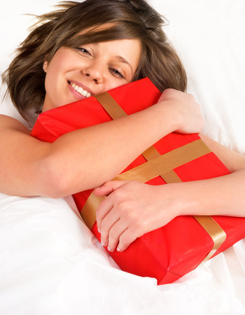 wideangle: Woman in bed with present