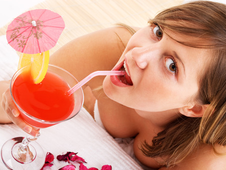 tropical drink: Woman drinking tropical drink