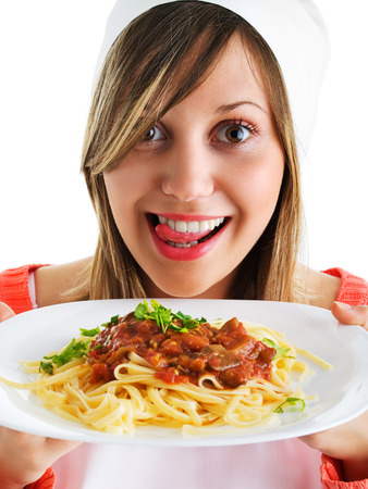 cheff: Cheff with spaghetti bolognese isolated on white, expressing positivity, licking her lips