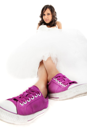 ''wide angle'': Bride with sneakers isolated on white, wide angle shot