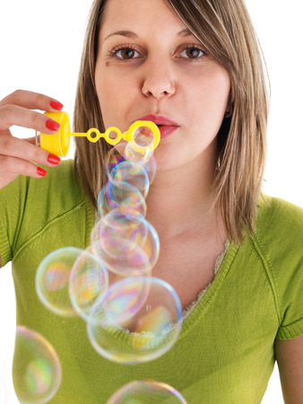 blowing bubbles: Girl blowing bubbles, isolated on white