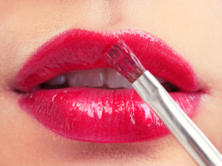 lips close up: Attractive woman lips with red lipstick, close up Stock Photo