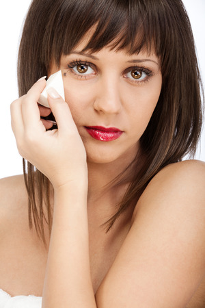 highkey: Beauty shot of woman applying make-up Stock Photo
