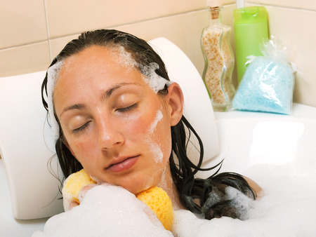 clr: Woman in bathtub Stock Photo
