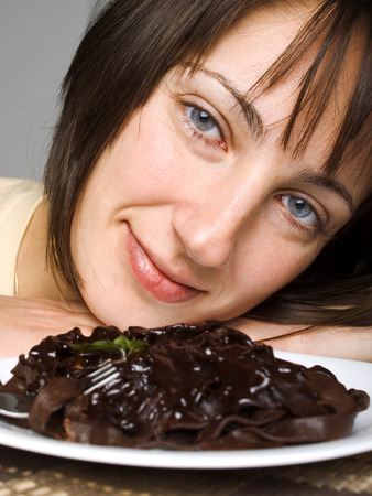 clr: Woman with chocolate tagliatelle