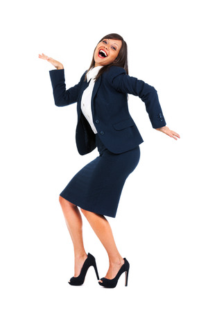 high heeled: Excited businesswoman dancing full of joy isolated on white background, expressing success Stock Photo