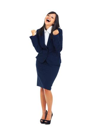 persona saltando: Empresaria que perfora el aire lleno de alegría aislado sobre fondo blanco, expresando éxito
