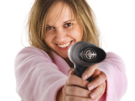 hair drier: Young woman with hair dryer