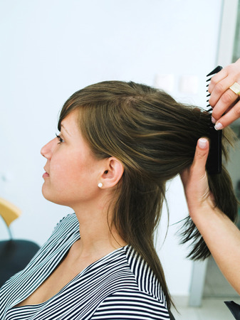 haircutting: Young woman at the hair studio