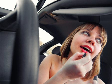 wideangle: Applying make up in the car