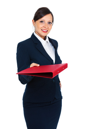 Businesswoman in a dark costume giving a folder with documents, suitable to represent a business person or secretary, isolated on white photo