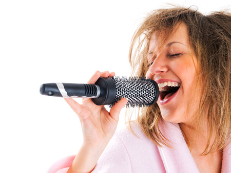 tousled: Woman singing with hairbrush