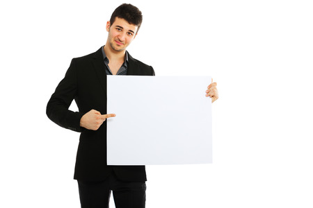 formal wear clothing: Young businessman holding blank board isolated on white background