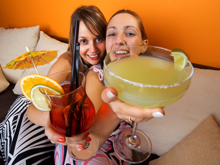 wideangle: Girls laughing with cocktails, wide angle