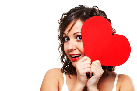 paper heart: Young woman holding red paper heart