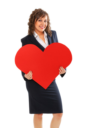 dressing up costume: Businesswoman holding red paper heart Stock Photo