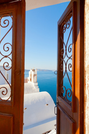 open gate: Open gate leading to a summer resort with a sea view in Oia, Santorini Stock Photo