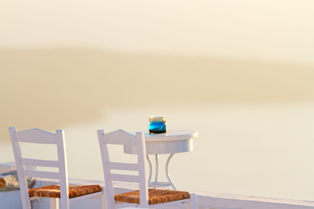 firostefani: Perfect white summer villa in Firostefani, Santorini at sunset with a terrace looking at the volcano