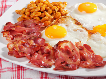 english breakfast: English breakfast - fried eggs, fried bacon and cooked beans Stock Photo