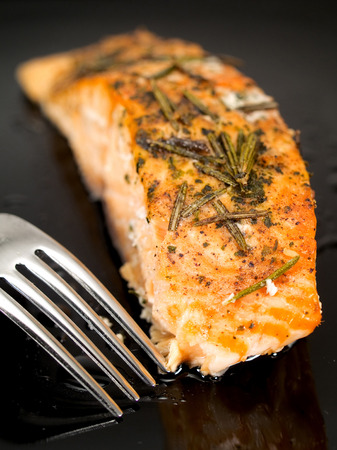 fish food: Baked salmon with olive oil and rosemary Stock Photo