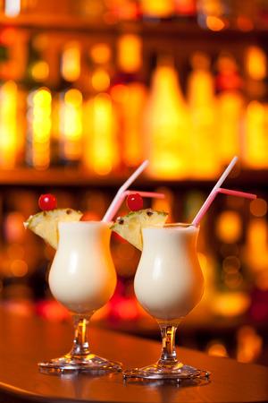 pina colada: Pina Colada cocktail shot on a bar counter in a nightclub Stock Photo