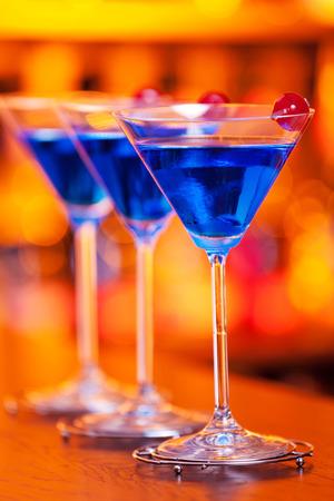 liqueurs: 1 12 oz vodka  1 oz Cointreau orange liqueur  1 oz Blue Curacao liqueur