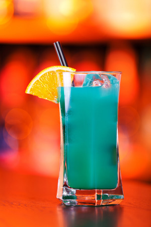 Ingredients:    3 oz vodka  1 oz Blue Curacao liqueur  1 splash cranberry juice  1 dash lime juice Stock Photo