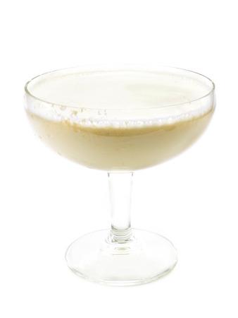 orgasm: Cocktail Orgasm isolated on white background. Made from 12 oz white creme de cacao, 12 oz amaretto almond liqueur, 12 oz triple sec, 12 oz vodka, 1 oz light cream