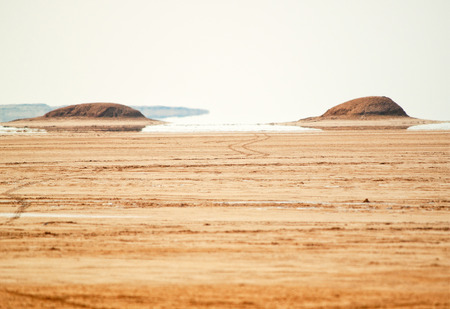 fata morgana: This place is popular in Sahara Desert, where you can see fata morgana, mirage - those hills in the distance are not real Stock Photo