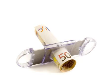 50 euro: Cutting 50 euro with cigar cutter