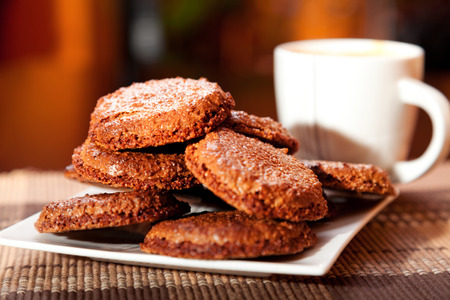 chocolate biscuit: Homemade chocolate cookies with cup of coffee, close up Stock Photo
