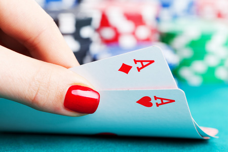 poker chips: Two aces and gambling chips Stock Photo