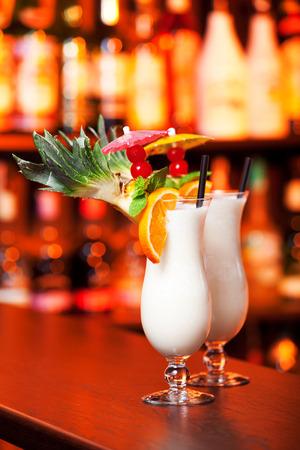 pina colada: Pina Colada cocktails shot on a bar counter in a nightclub Stock Photo