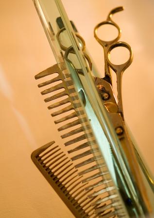 haircutting: Hair Studio Stuff - Haircutting Scissors and Hair Brushes Stock Photo
