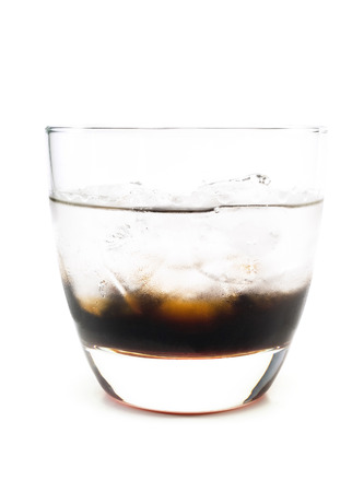 liqueurs: Black russian cocktail isolated on white background. It is made from 34 oz coffee, iqueur, 1 12 oz vodka