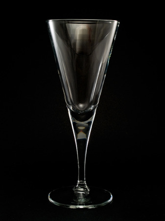 champagne flute: Empty Champagne Flute isolated on black background Stock Photo
