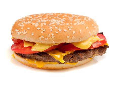 comida rapida: Hamburguesa con carne, queso y tomate Foto de archivo