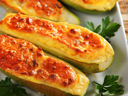 Stuffed zucchini with cheese, baked with mozzarella Stock Photo